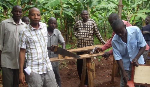 image of some the people from the village involved in making furniture