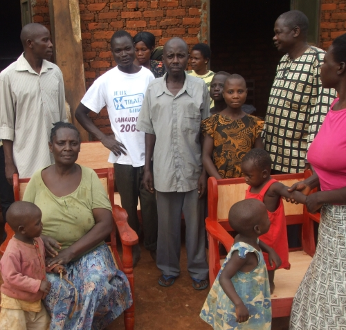 image of group of people from the Ugandan Village and furniture produced by the project